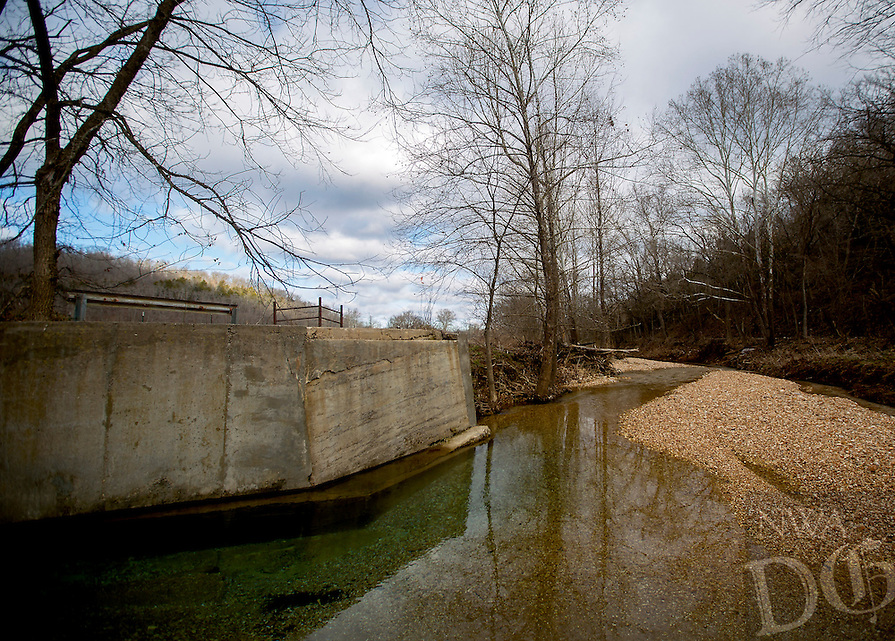 NWA Democrat-Gazette/JASON IVESTER<br /> The site on Friday, Jan. 15, 2016, where a bridge once crossed Limekelm Hollow Creek as part of Corinth Road in Garfield.