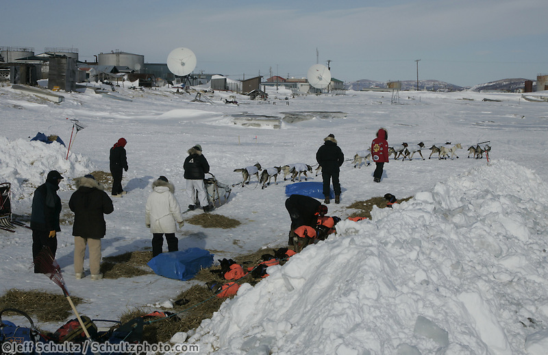 Melanie Gould leaves the windbreaks at the Unalakleet checkpoint on Monday afternoon.