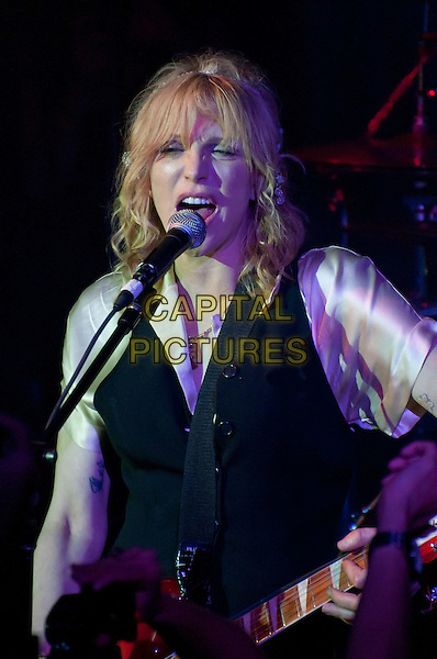 Courtney Love.One Management 10th Anniversary Party - Performance, New York, NY, USA..September 6th, 2011.stage concert live gig performance music half length singing black waistcoat white blouse silk satin guitar.CAP/ADM/CS.©Christopher Smith/AdMedia/Capital Pictures.