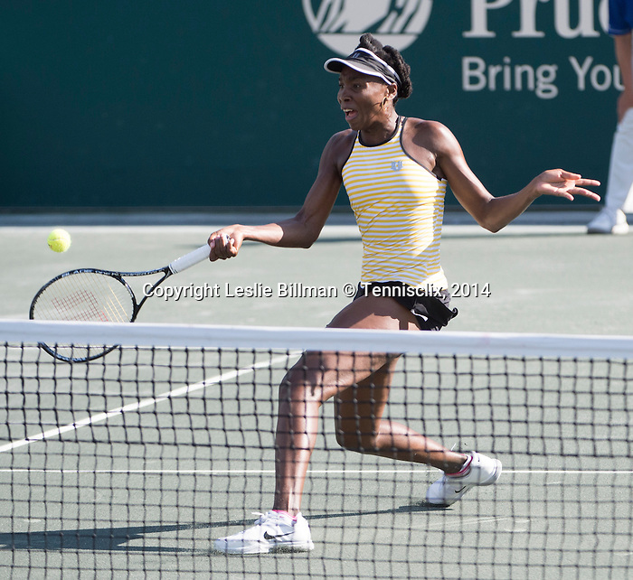 Venus Williams (USA) defeats Chanelle Scheepers (RSA) at the Family Circle Cup in Charleston, South Carolina on April 2, 2014.