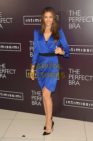 Irina Shayk (Irina Shaykhlislamova).launches Intimissimi Perfect Bra Collection and book at.Intimissimi, Oxford Street, London, England 24th April 2012.full length blue wrap dress black belt hand .CAP/PL.©Phil Loftus/Capital Pictures.