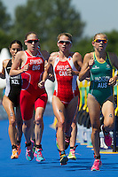 24 JUL 2014 - GLASGOW, GBR - The front pack on the run of Andrea Hewitt (NZL) (left) of New Zealand, Jodie Stimpson (ENG) (second from the left) from England, Aileen Reid (NIR) (third from the left, partly hidden) from Northern Ireland, Kirsten Sweetland (CAN) (third from the right) from Canada, Vicky Holland (ENG) (hidden) from England and, Emma Jackson (AUS) (right) from Australia run past transition for the start of their second run lap during the elite women's 2014 Commonwealth Games triathlon in Strathclyde Country Park in Glasgow, Scotland  (PHOTO COPYRIGHT &copy; 2014 NIGEL FARROW, ALL RIGHTS RESERVED)<br /> *******************************<br /> COMMONWEALTH GAMES <br /> FEDERATION USAGE <br /> RULES APPLY<br /> *******************************