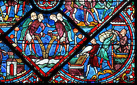 The years of plenty (left), with men pouring harvested grain from their clothes and the Egyptians storing provisions (right), with men pouring grain into storage boxes, from the Life of Joseph stained glass window, 13th century, in the nave of Chartres cathedral, Eure-et-Loir, France. Chartres cathedral was built 1194-1250 and is a fine example of Gothic architecture. Most of its windows date from 1205-40 although a few earlier 12th century examples are also intact. It was declared a UNESCO World Heritage Site in 1979. Picture by Manuel Cohen