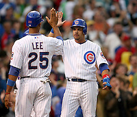 August 18, 2007: Chicago Cub Derek Lee congratulates Aramis Ramirez after Ramirez hit a two run homer against the St. Louis Cardinals at Wrigley Field in Chicago, IL.  Photo by:  Chris Proctor/Four Seam Images