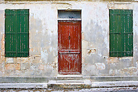 Door and shutters, Ile De Re, France. RESERVED USE - NOT FOR DOWNLOAD -  FOR USE CONTACT TIM GRAHAM