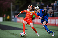 Seattle, Washington -  Saturday April 22, 2017: Janine Beckie and Megan Rapinoe during a regular season National Women's Soccer League (NWSL) match between the Seattle Reign FC and the Houston Dash at Memorial Stadium.