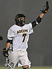 Chris Racalbuto #7 of Adelphi University reacts after scoring a goal in the fourth quarter of a rain-filled first round game against Pace in the NCAA Division II Tournament at Motamed Field in Garden City, NY on Saturday, May 13, 2017.
