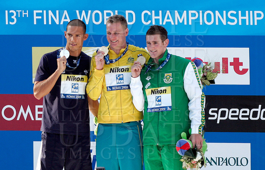 Brenton Rickard of Australia, center, winner of the men's 100 meters breaststroke, shows his gold medal flanked by silver medalist Hugues Duboscq of France, left, and bronze medalist Cameron Van Der Burgh, at the Swimming World Championships in Rome, 27 July 2009. Brenton set the new World record clocking 58.58..UPDATE IMAGES PRESS/Riccardo De Luca