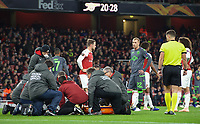 Medical staff work on injured Danny Welbeck of Arsenal during the UEFA Europa League group match between Arsenal and Sporting Clube de Portugal at the Emirates Stadium, London, England on 8 November 2018. Photo by Andrew Aleks / PRiME Media Images.<br /> .<br /> (Photograph May Only Be Used For Newspaper And/Or Magazine Editorial Purposes. www.football-dataco.com)
