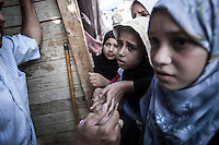 In this Friday, Aug. 09, 2013 photo, young female supporters of the ousted president Mohammed Morsi queue for food in the sit-in at streets nearby Al-Raba'a Alawya mosque in the Nasr district of Cairo. (Photo/Narciso Contreras).
