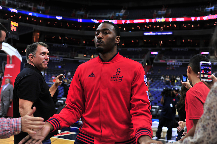 John Wall high five fans prior to tip-off against the New York Knicks at the Verizon Center in Washington, D.C. on Friday, October 9, 2015.  Alan P. Santos/DC Sports Box
