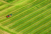 High above a Middlebury farmer cutting a green field, Addison County, Vermont.