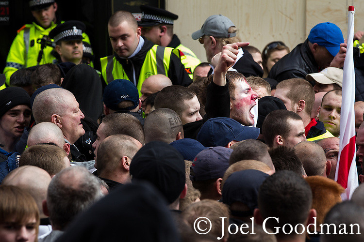 © Joel Goodman - 07973 332324 . 02/04/2011 . Blackburn , UK . The English Defence League ( EDL ) hold a demonstration in Blackburn . Photo credit : Joel Goodman