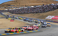 Jun. 21, 2009; Sonoma, CA, USA; NASCAR Sprint Cup Series driver Jeff Gordon (24) races alongside Matt Kenseth (17) during the SaveMart 350 at Infineon Raceway. Mandatory Credit: Mark J. Rebilas-
