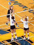 BROOKINGS, SD - NOVEMBER 9:  Tiara Gibson #7 from South Dakota State University tries for a kill past Jordan Jackson #15 and Sarah Fetter #17 from Western Illinois in the second game of their match Saturday at Frost Arena. (Photo by Dave Eggen/Inertia)