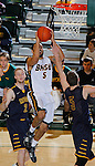 SPEARFISH, SD - DECEMBER 21, 2013:  Joey Mitchell #5 of Black Hills State goes for a layup between Regis defenders Mike MacKelvie #2 and Kevin Marshall #5 during their Rocky Mountain Athletic Conference game Saturday at the Donald E. Young Center in Spearfish, S.D.  (Photo by Dick Carlson/Inertia)