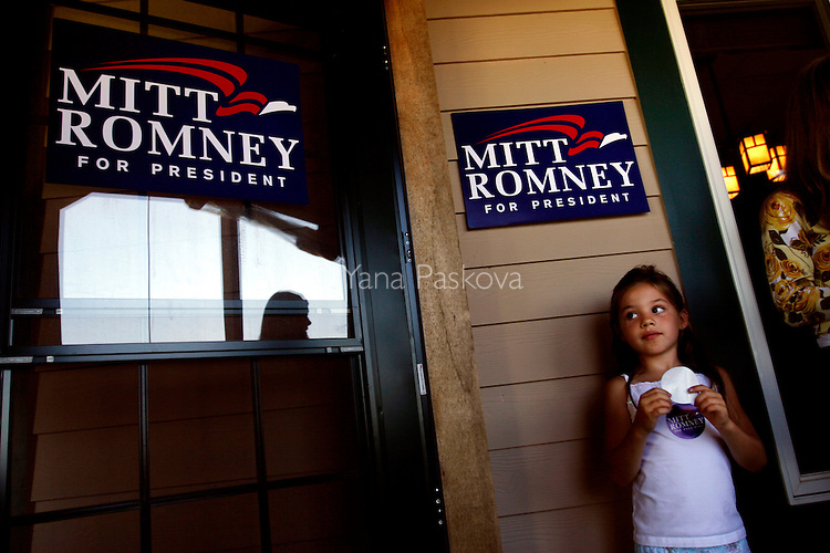 A young volunteer hands out campaign stickers during an event with Republican Presidential candidate Mitt Romney (R-MA) at Wileywood restaurant in Okoboji, IA, on July 20, 2007.