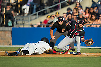 Adron Chambers (1) of the Sussex County Miners dives back into first base as Conrad Gregor (3) New Jersey Jackals fields a pick-off throw at Skylands Stadium on July 29, 2017 in Augusta, New Jersey.  The Miners defeated the Jackals 7-0.  (Brian Westerholt/Four Seam Images)