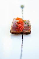 Salmon caviar on top of a slice of tuna