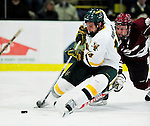 24 November 2009: University of Vermont Catamount forward Brian Roloff, a Senior from West Seneca, NY, scores Vermont's second goal to take a 2-1 second period lead against the University of Massachusetts Minutemen at Gutterson Fieldhouse in Burlington, Vermont. The Minutemen defeated the Catamounts 6-2. Mandatory Credit: Ed Wolfstein Photo