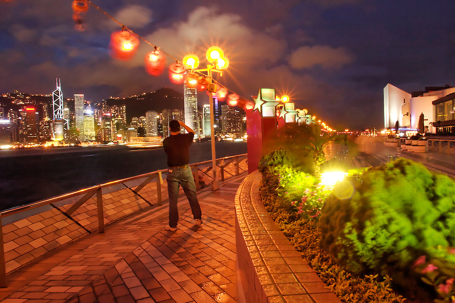 Promenade and lanterns frame Hong Kong skyline, Avenue of the Stars, Tsim Sha Tsui Promenade, Kownloon waterfront, Hong Kong SAR, China, Asia