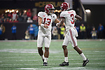 ATLANTA, GA - JANUARY 08: Tua Tagovailoa #13 and Calvin Ridley #3 of the Alabama Crimson Tide celebrate a touchdown against the Georgia Bulldogs during the College Football Playoff National Championship held at Mercedes-Benz Stadium on January 8, 2018 in Atlanta, Georgia. Alabama defeated Georgia 26-23 for the national title. (Photo by Jamie Schwaberow/Getty Images)