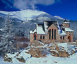 The St. Catherine's Chapel of Sienna at St. Malo, sits quietly in the snow below Mt. Lady Washington, along the Peak to Peak Scenic Byway, near Estes Park, Colorado.