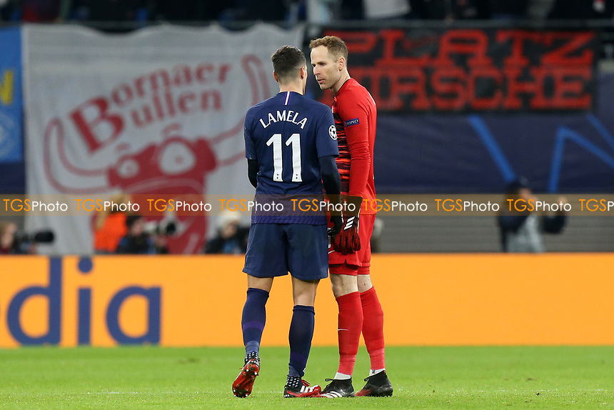 Peter Gulacsi of RB Leipzig and Erik Lamela of Tottenham Hotspur get involved in a heated argument when the keeper tried to join in the celebrations for the third Leipzig goal during RB Leipzig vs Tottenham Hotspur, UEFA Champions League Football at the Red Bull Arena on 10th March 2020