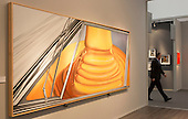 "London, England. 15 October 2014. A man walks past the painting ""Highway Trust"" 1977 by James Rosenquist. Fine art fair Frieze Masters 2014 in Regent's Park, London. Photo: Bettina Strenske"