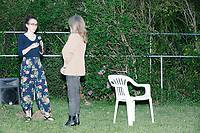 An attendee asks a question to Democratic presidential candidate and spiritual guru Marianne Williamson as the candidate speaks to a small crowd in the back yard of Kathleen O'Donnell at a campaign house party event in Keene, New Hampshire, on Wed., May 22, 2019.