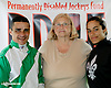 Jose Caraballo, Francis Chew and Carol Cedeno in the PDHF (Permanently Disabled Jockeys Fund) booth at Delaware Park on 7/2614