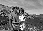 Greg Desin and Sylvia Mayhew Desin, Ansel&rsquo;s granddaughter.<br /> <br /> In August of 1987, the family and friends of Ansel Adams made a trip to Mount Ansel Adams to honor Ansel by putting his ashes on the mountain.  Leading the trip were Dr. Michael Adams and his wife, Jeanne, their son, Matthew, and daughter, Sarah.  Also in the group were Ansel&rsquo;s daughter, Anne Adams Helms, and her husband, Ken Helms, and Anne's daughters, Virginia (Ginny) Mayhew and Sylvia Mayhew Desin, and Sylvia&rsquo;s husband, Greg Desin.  Other members of the trip were Roger and Mitzi Hall, Matt Weston, Mrs. Desin (Greg&rsquo;s mother), and Billy Butler.  The Adams family invited me along with Leo Stutzin (Modesto Bee reporter) and my eldest son, Aaron Golub.  <br /> <br /> With some of us on horseback and others on foot, we began the hike at Tuolumne High Sierra Camp and headed to Vogelsang High Sierra Camp for the first night out.  The second day, we began by climbing through Vogelsang Pass, then descended by switchback down to Lewis Creek.  After climbing up from the creek we hiked by the Cony Crags before descending into the Lyell Fork of the Merced River ending up near Hutchings Creek at what is now referred to as the Ansel Adams Camp.  <br /> <br /> This camp was originally known generically as a Sierra Club Camp, but has more recently been referred to as Ansel Adams Camp because in 1934, Ansel led a Sierra Club outing to the Lyell Fork of the Merced River.  After the group climbed the then-unnamed peak that Adams called &ldquo;The Tower in Lyell Fork,&quot; they gathered around the campfire and agreed that the peak should bear Ansel&rsquo;s name.  The U.S. Geological Survey does not, however, permit naming features for living individuals, so the peak did not officially become Mt. Ansel Adams until 1985, one year and one day after his death.  Photo by Al Golub/Golub Photography
