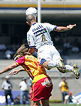 UNAM Pumas defender Dario Veron (R) fights for the ball with UAG Tecos forward Carlos David Casartelli during their soccer match march 19, 2006 at the University Stadium in Mexico City. UAG Tecos won 1-0 to UNAM Pumas. Photo by © Javier Rodriguez
