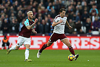 Burnley's James Tarkowski and West Ham United's Marko Arnautovic<br /> <br /> Photographer Rob Newell/CameraSport<br /> <br /> The Premier League - West Ham United v Burnley - Saturday 10th March 2018 - London Stadium - London<br /> <br /> World Copyright &copy; 2018 CameraSport. All rights reserved. 43 Linden Ave. Countesthorpe. Leicester. England. LE8 5PG - Tel: +44 (0) 116 277 4147 - admin@camerasport.com - www.camerasport.com