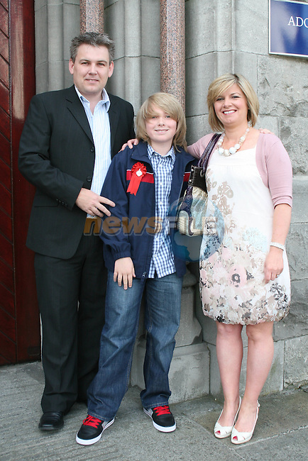 Liam, Derek and Sinead Glynn at the Confirmation in St.Mary's Church...Photo NEWSFILE/Jenny Matthews.(Photo credit should read Jenny Matthews/NEWSFILE)....This Picture has been sent you under the condtions enclosed by:.Newsfile Ltd..The Studio,.Millmount Abbey,.Drogheda,.Co Meath..Ireland..Tel: +353(0)41-9871240.Fax: +353(0)41-9871260.GSM: +353(0)86-2500958.email: pictures@newsfile.ie.www.newsfile.ie.FTP: 193.120.102.198.