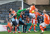 Goalkeeper Elliot Justham of Luton Town punches clear during a Wycombe attack during the Sky Bet League 2 match between Wycombe Wanderers and Luton Town at Adams Park, High Wycombe, England on 6 February 2016. Photo by Andy Rowland.