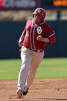 Cody Reine (11) of the Oklahoma Sooners runs the bases against the Pepperdine Waves at Eddy D. Field Stadium on February 18, 2012 in Malibu,California. Pepperdine defeated Oklahoma 10-0.(Larry Goren/Four Seam Images)