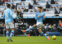 30th November 2019; St James Park, Newcastle, Tyne and Wear, England; English Premier League Football, Newcastle United versus Manchester City; Allan Saint-Maximin of Newcastle United shoots past John Stones of Manchester City but the shot was saved - Strictly Editorial Use Only. No use with unauthorized audio, video, data, fixture lists, club/league logos or 'live' services. Online in-match use limited to 120 images, no video emulation. No use in betting, games or single club/league/player publications