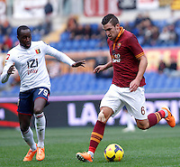 Calcio, Serie A: Roma-Genoa. Roma, stadio Olimpico, 12 gennaio 2014.<br /> AS Roma midfielder Kevin Strootman, of the Netherlands, is challenged by Genoa midfielder Cabral, of Switzerland, left, during the Italian Serie A football match between AS Roma and Genoa, at Rome's Olympic stadium, 12 January 2014. <br /> UPDATE IMAGES PRESS/Isabella Bonotto