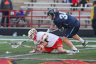 College Park, MD - March 18, 2017: Maryland Terrapins Jon Garino (12) and Villanova Wildcats Connor Kirst (34) tries  to get the groundball during game between Villanova and Maryland at  Capital One Field at Maryland Stadium in College Park, MD.  (Photo by Elliott Brown/Media Images International)