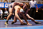CLEVELAND, OH - MARCH 10: Nick Velez, of Ithaca, left, wrestles Lucas Jeske, of Augsburg, in the 165 weight class during the Division III Men's Wrestling Championship held at the Cleveland Public Auditorium on March 10, 2018 in Cleveland, Ohio. (Photo by Jay LaPrete/NCAA Photos via Getty Images)