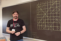 New York, NY, USA - June 24-25, 2017: OrigamiUSA 2017 Convention at St. John's University, Queens, New York, USA. Enrique Martinez, Spain, teaches a class how to fold his design Songbird.