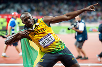 05.08.2012 Stratford, England. Jamaicas Usain Bolt (JAM) wins the Men's 100m Final ahead of Jamaicas Yohan Blake (JAM) in second and Americas Justin Gatlin (USA) in third during the Athletics on Day 9 of the London 2012 Olympic Games at the Olympic Stadium. Bolt ecorded a new Olympic record time of 9.63.