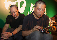 Occupy Central leaders Benny Tai (L) and Chan Kin-man (R) are are seen at an overnight mass sit-in in front of Hong Kong's Central government offices, Hong Kong, China, 28 September 2014. It was announced at the student protest that the society-wide mass disobedience campaign, Occupy Central would commence immediatley - three whole days earlier than was previously forecast. The students and the Occupy Central supporters are protesting the slow pace of democratic reform imposed by the Chinese government on the Hong Kong people.