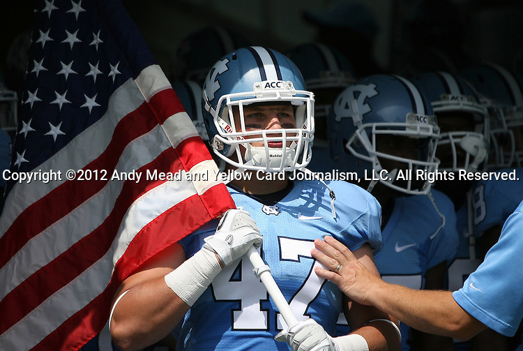 01 September 2012: UNC's Dan Mastromatteo waits to lead his teammates onto the field. The University of North Carolina Tar Heels played the Elon University Phoenix at Kenan Memorial Stadium in Chapel Hill, North Carolina in a 2012 NCAA Division I Football game. UNC won the game 62-0.