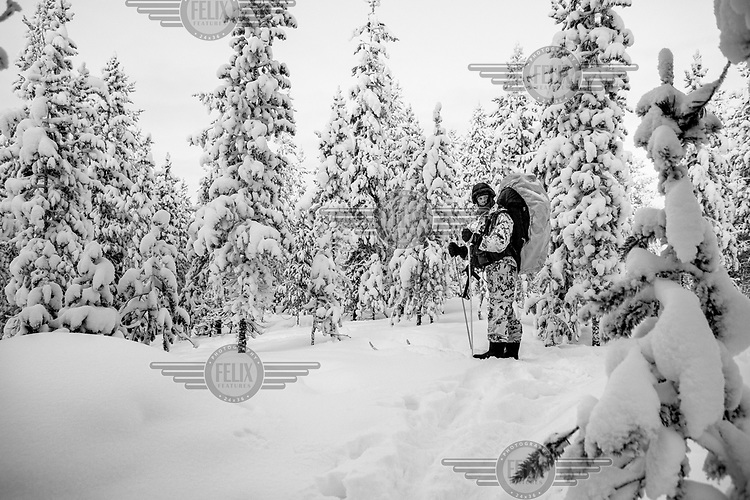 A Border Guards recruit stands in the forest during training. He will spend the night outside enduring temperatures dropping to minus 30 Celsius.