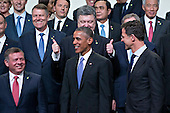 Petro Poroshenko, Ukraine's president, top center, gestures behind United States President Barack Obama during a family photo at the Nuclear Security Summit in Washington, D.C., U.S., on Friday, April 1, 2016. After a spate of terrorist attacks from Europe to Africa, Obama is rallying international support during the summit for an effort to keep Islamic State and similar groups from obtaining nuclear material and other weapons of mass destruction. <br /> Credit: Andrew Harrer / Pool via CNP