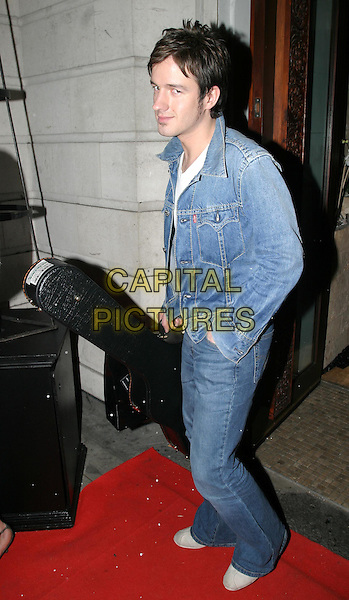 ALISTAIR GRIFFIN.Public Players charity party at Taman Gang, Park Lane.17 March 2004.full length, full-length, denim jeans, levis jacket, guitar case.www.capitalpictures.com.sales@capitalpictures.com.© Capital Pictures.