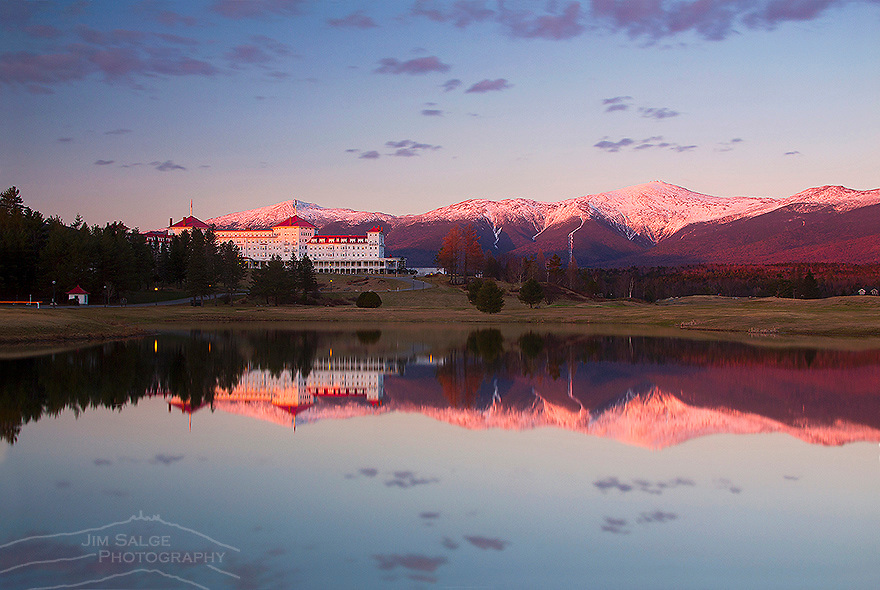 Sunset reflection of the Presidential Range Alpenglow and Mount Washington Hotel from Bretton Woods, NH on a perfect spring evening