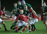 Ireland full back Stuart Olding runs into trouble as the Welsh defence closes in..Under 20 Six Nations.Wales v Ireland.Eirias - Colwyn Bay.01.02.13.©Steve Pope